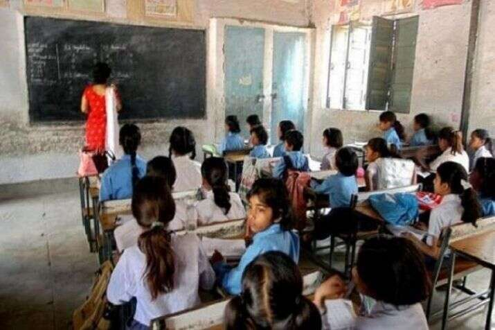india, school, teacher caught on camera, slippers, Shiksha Mitra