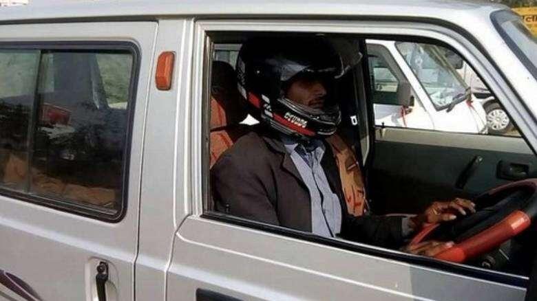 motorist fined, car driver not wearing helmet, india, offbeat news