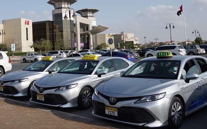 abu dhabi taxis, dubai taxis, isolators in uae taxis, uae fights coronavirus